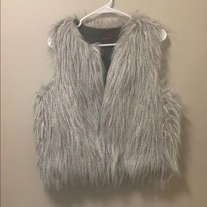 The limited grey fur vest medium/large